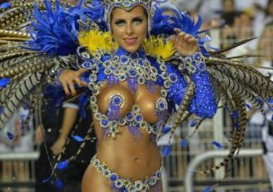 A reveler of the Gavioes da Fiel samba school performs during the second night of carnival parade at the Sambadrome in Sao Paulo, Brazil on March 1, 2014. Gavioes da Fiel's theme for this year's carnival is an homage to Brazilian former football star Ronaldo.  AFP PHOTO / NELSON ALMEIDA